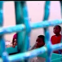 Children of an African migrant from Nigeria who have been jailed with their mother in Ramle as Israel tries to deport her (Channel 10 screen capture)