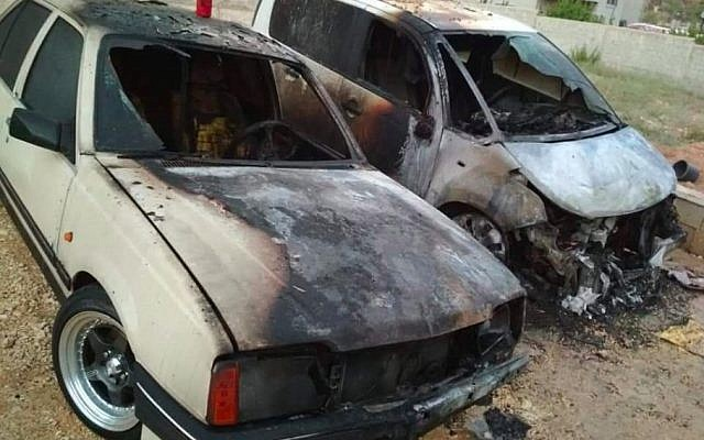 Palestinian cars torched in an apparent hate crime in the northern West Bank town of Urif on July 13, 2018. (Courtesy)