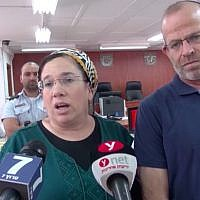 Nirit Zamora (L) speaks to reporters inside the Judea Military Court beside her husband ahead of the sentencing of her attacker on July 16, 2018. (Screen capture/Israel National News)