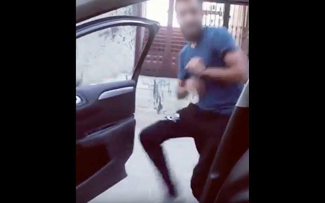 A Palestinian man performs the 'Kiki Challenge' (YouTube screenshot)