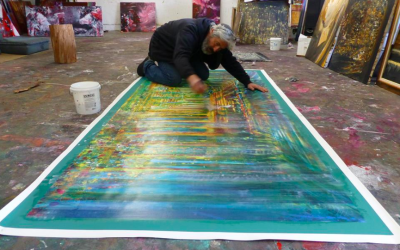 Artist Yoram Raanan putting the final touches on one of his recent artworks (Courtesy Yoram Raanan)