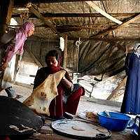 Illustrative image of three Bedouin women making pita on May 9, 2006. (Nati Shohat /Flash90)