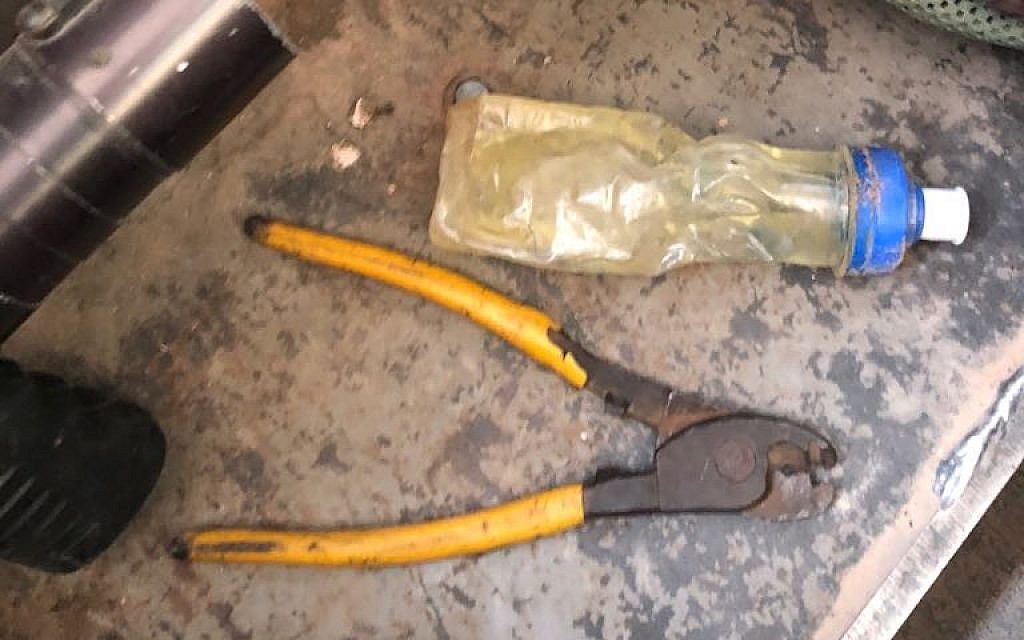 A set of wire-cutters and a bottle of flamable liquid that the military found in the possession of a Palestinian man who tried to cross into Israel from the southern Gaza Strip on July 11, 2018. (Israel Defense Forces)