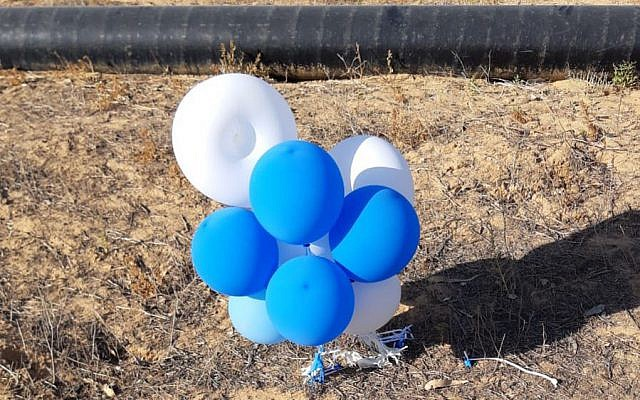 A cluster of balloons launched from the Gaza Strip that landed inside the southern Israel Eshkol region on July 12, 2018. (Eshkol Security)