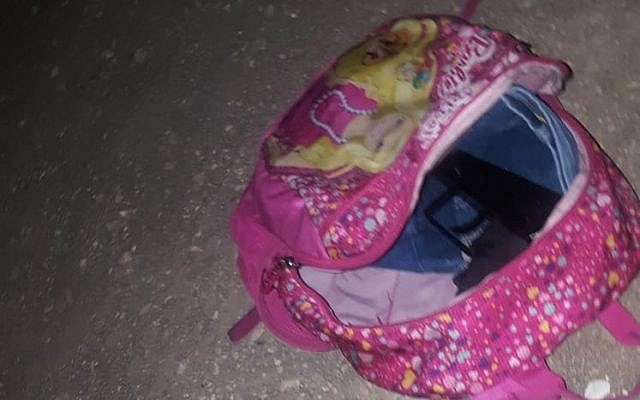 A Carlo-style submachine gun, inside a pink Barbie backpack, which was dropped by a Palestinian suspect who police say tried to enter Israel from the northern West Bank on July 16, 2018. (Israel Police)
