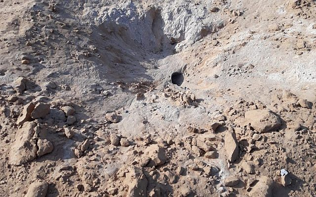 The crater caused by a rocket fired from the Gaza Strip striking a field outside a community in the Eshkol region on July 19, 2018. (Eshkol security)