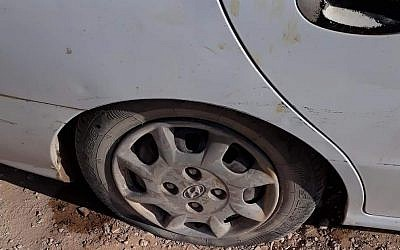 A tire slashed in an apparent hate crime attack in the Palestinian village of al-Mughayyir on July 30, 2018. (Israel Police)