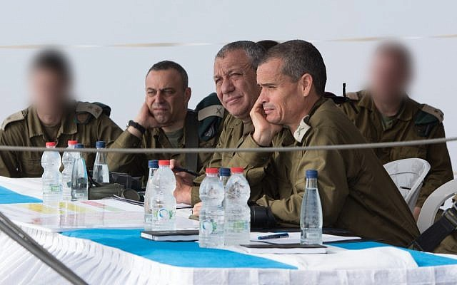 IDF Chief of Staff Gadi Eisenkot, center, head of the Northern Command Maj. Gen. Yoel Strick, right, and the head of Military Intelligence's Research Division Brig. Gen. Dror Shalom hear a briefing on the fighting in southern Syria, during a visit along the Syrian border on July 4, 2018. (Israel Defense Forces)