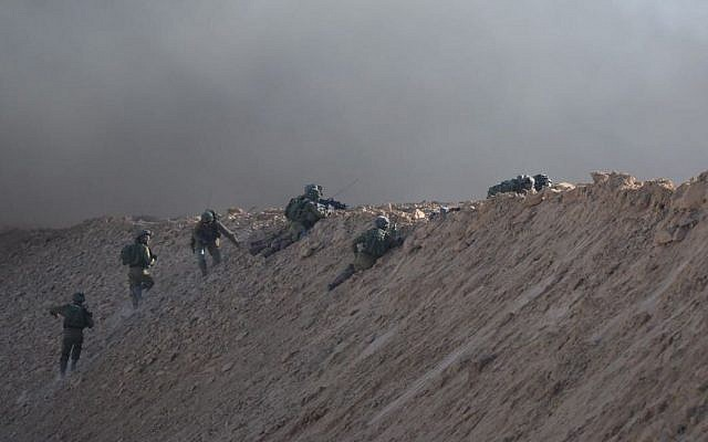 Israeli soldiers perched in defensive positions on an embankment near the Gaza border during a violent Palestinian protest, July 27, 2018 (Courtesy IDF)