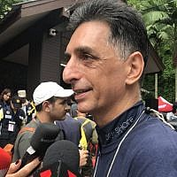Raphael Aroush speaking to the media outside  the the Tham Luang Nang Non cave in Thailand on July 6, 2018. (Natasha Squarey)