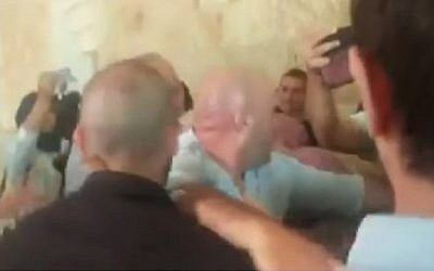 A brawl between families of slain Palestinian terrorists and those of Israeli victims at the Supreme Court in Jerusalem on July 17, 2018 (Hadashot TV screenshot)