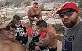 Tunisian men photographed barbecuing in the Jewish cemetery in the coastal city of Sousse, July 2018. (Courtesy)