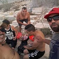 Tunisian men photographed barbecuing in the Jewish cemetery in the coastal city of Sousse. (Courtesy)