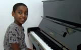 10-year-old Oshri Bitau at his new piano in the family's Nazareth Illit home, July 15, 2018. (Hadashot screen capture)