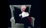 "Dick Cheney signs a ""waterboard kit,"" or jug of water, on Sacha Baron Cohen's upcoming show. (Twitter)"