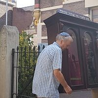 Tom Furstenberg, right, and a member of the Jewish community of Deventer carries out the Torah ark of their former synagogue, July 30, 2018. (Cnaan Liphshiz/JTA)