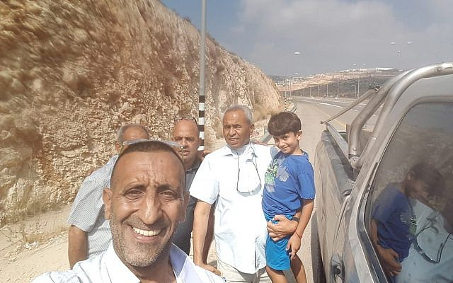 Seven-year-old Arab Israeli Karim Jumhour of Qalansawe (R) is seen following his release after being held in the West Bank by kidnappers, on July 13, 2018. (Israel Police)