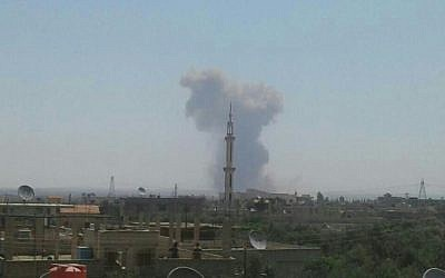 Smoke rises after a reported explosion near the town of Mhajja in southern Syria (Facebook photo)