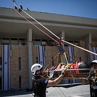 Members of the Knesset Honor Guard, Home Front Command, firefighters, IDF, Israel Police and Magen David Adom Emergency Medical Services participate in an emergency drill simulating an earthquake at the Knesset, Jerusalem, June 13, 2017. (Hadas Parush/Flash90)