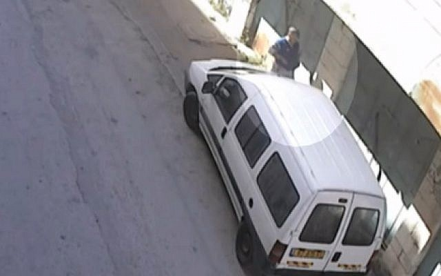 A international observer for TIPH suspected of slashing the tires of an Israeli settler in Hebron. (Hadashot news screenshot)