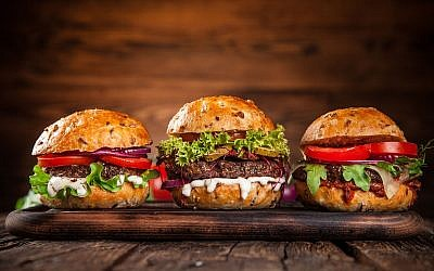 Illustrative image of hamburgers (Kesu01; iStock by Getty Images)
