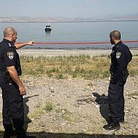 Police searching for a pair of missiles fired from Syria which eyewitnesses said landed in the Sea of Galilee, July 26, 2018 (Police Spokesman's Unit)
