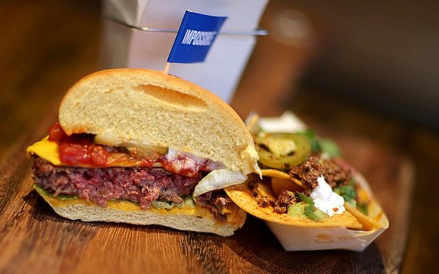 The Impossible Burger is vegetarian, but it bleeds like a normal meat patty. (Jonathan Wiggs/The Boston Globe via Getty Images/JTA)