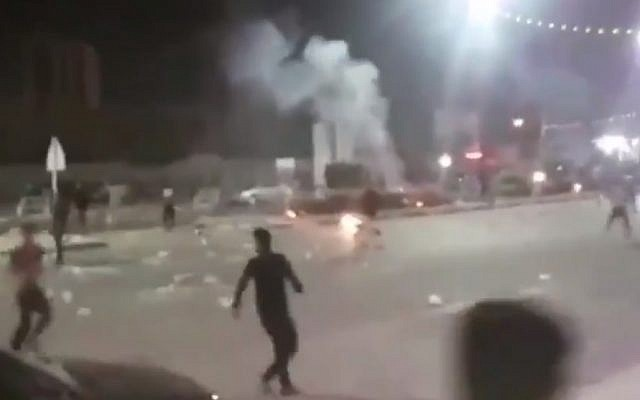 A still from video shared on social media showing protests in the Iranian city of Khorramshahr, on June 30, 2018. (screen capture: Twitter/BBC)