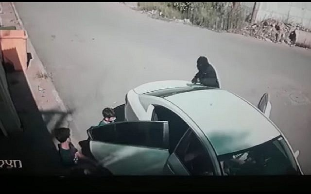 This screen capture shows a masked man kidnapping 7-year-old Karim Jumhour from outside his home in the Arab city of Qalansawe in July 2018. (Screen capture: Facebook)