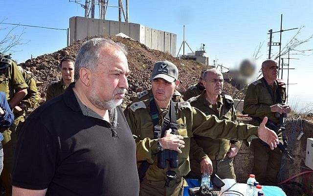 Defense Minister Avigdor Liberman hears a briefing from the head of the IDF Northern Command, Maj. Gen. Yoel Strick, on developments in southern Syria, on July 10, 2018. (Ariel Hermoni/Defense Ministry)