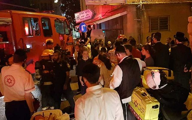 Firefighters outside an apartment fire in central Jerusalem on July 27, 2018. (Magen David Adom)