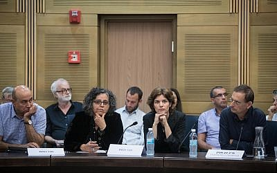 From left: Lawmakers Zouheir Bahloul and Aida Touma-Sliman  (Joint Arab List), Tamar Zandberg (Meretz) and Dov Kheinin (Joint Arab List) listen to presentations during a special conference on children growing up under occupation held at the Knesset on July 2, 2018. (Hadas Parush/ Flash90)