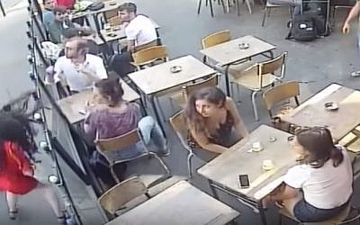 Marie Laguerre, a 22-year-old student is punched by the man who sexually assaulted her in brad daylight outside a cafe on July 25, 2018. (screen capture: YouTube)