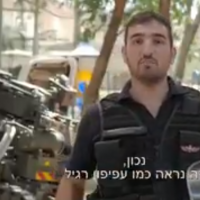 A police sapper in an informational video by the Israel Police urging kids to steer clear of potentially dangerous kites and balloons over the summer that may have been sent over the border from Gaza, in a screen shot taken on July 6, 2018. (Israel Police/Twitter screenshot)