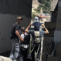 Private security guards funded by the state escort a Jewish family to Ateret Cohanim's Beit Rachel in the Batan al-Hawa district of Silwan, East Jerusalem, on July 31, 2018. (Sue Surkes/Times of Israel.)
