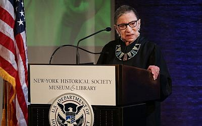 US Supreme Court Justice Ruth Bader Ginsburg prepares to administer the Oath of Allegiance to candidates for US citizenship at the New-York Historical Society in New York City, on April 10, 2018. (Spencer Platt/Getty Images via JTA)
