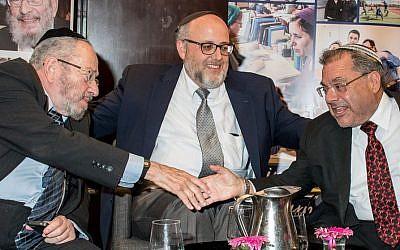 Rabbi Chaim Brovender, Rabbi Jeffrey Saks, and Rabbi Shlomo Riskin, at a reunion event hosted by the WebYeshiva/ATID and Ohr Torah Stone institutions, July 2, 2018. (courtesy)