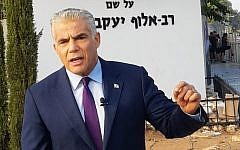 Yesh Atid leader MK Yair Lapid speaks to reporters outside the IDF's main recruitment base, the Bakum, in Tel Hashomer on August 13, 2018. (Courtesy)