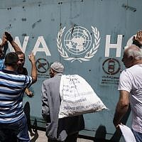 Employees of the UN Relief and Works Agency for Palestine Refugees in the Near East (UNRWA) and their families protest against job cuts announced by the agency outside its offices in Gaza City on July 31, 2018. (AFP Photo/Said Khatib)