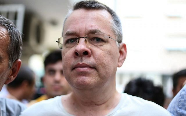 In this file photo taken on July 25, 2018, US pastor Andrew Craig Brunson is escorted by Turkish plainclothes police officers to his house on in Izmir. (AFP Photo)