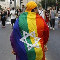 Illustrative: Participants take part in the annual Jerusalem Gay Pride parade on August 2, 2018. (AFP Photo/Menahem Kahana)