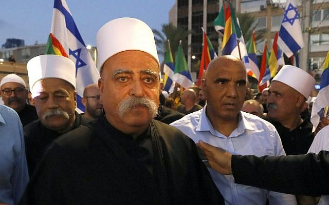 Israeli Druze spiritual leader Sheikh Muafak Tarif arrives at a rally where members of his community and their supporters demonstrated during a rally to protest against the Jewish nation-state law in Tel Aviv on August 4, 2018. (AFP PHOTO / JACK GUEZ)