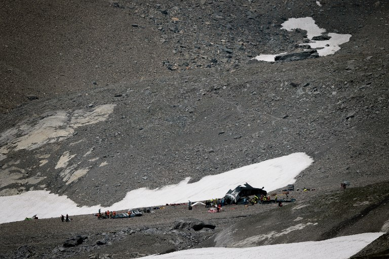 Old-time plane crashes in Swiss Alps, killing 20 on board
