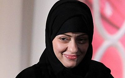In this file photo taken on March 8, 2012  political activist Samar Badawi of Saudi Arabia is presented with an International Women of Courage Award by the US Secretary of State and the first lady during a ceremony at the State Department in Washington, DC. (AFP PHOTO / GETTY IMAGES NORTH AMERICA / ALEX WONG)