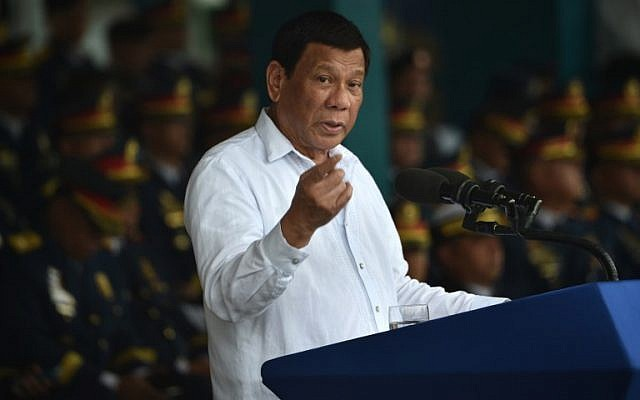 Philippine President Rodrigo Duterte gives a speech the 117th police anniversary celebration at the national headquarters in Manila on August 8, 2018. (AFP Photo/Ted Aljibe)