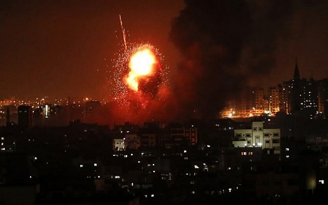 A picture taken on August 8, 2018 shows a fireball exploding during Israeli air strikes in Gaza City. (AFP PHOTO / MAHMUD HAMS)
