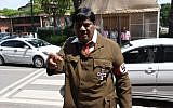Indian film actor-turned-politician Naramalli Sivaprasad arrives at parliament dressed as Adolf Hitler to press for government funding for his home state of Andhra Pradesh, in New Delhi on August 9, 2018. (AFP)