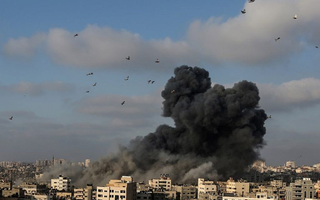 A plume of smoke rises from the remains of a building west of Gaza City that was targeted by the Israeli Air Force in response to a rocket attack that hit southern Israel earlier in the day on August 9, 2018. (Mahmud Hams/AFP)