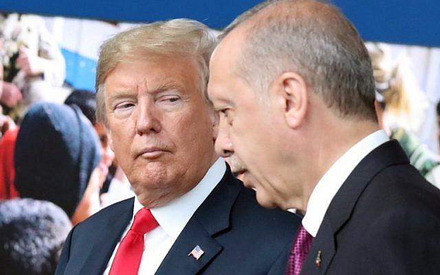 US President Donald Trump (L) talks to Turkey's President Recep Tayyip Erdogan (R) as they arrive for the NATO summit, at the NATO headquarters in Brussels, July 11, 2018. (Tatyana ZENKOVICH/AFP)