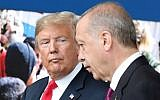 In this file photo taken on July 11, 2018, US President Donald Trump (L) speaks with Turkey's President Recep Tayyip Erdogan (R) as they arrive for a NATO summit at NATO headquarters in Brussels. (AFP Photo/Pool/Tatyana Zenkovich)